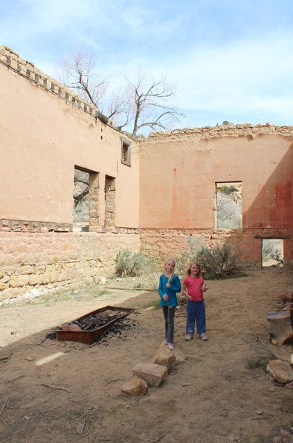 Emma and Sarah in ruins of store in Sego, UT