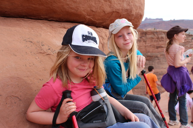 Emma and Sarah next to Delicate Arch