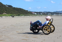 Sarah fun-cycling on Manzanita Beach