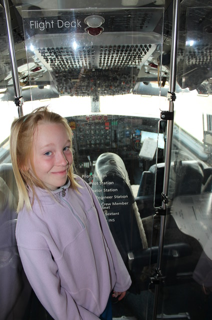 Emma in front of the old Air Force One cockpit