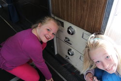 Sarah and Emma in front of the safes on board Air Force One where the nuclear football was stored