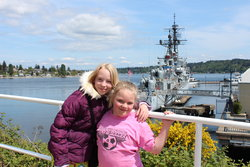 Emma and Sarah in front of USS Turner Joy