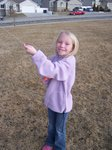 Emma flying a kite in the park