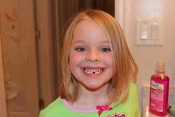 Sarah's first tooth gone!