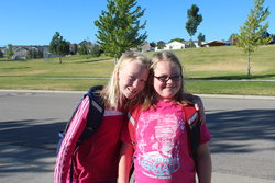 Emma and Sarah, first day of 6th and 4th grade