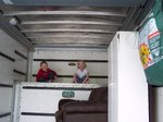 Nathan and Emma playing in the back of a U-Haul