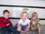 Sarah, Nathan and Emma playing in the back of a U-Haul